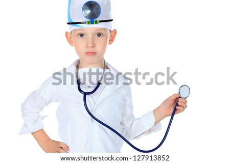Portrait of a cute boy playing doctor with a stethoscope. Isolated over white. - stock photo