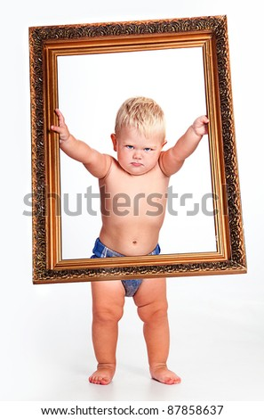 Portrait of a cute boy without diapers in picture frame - stock photo