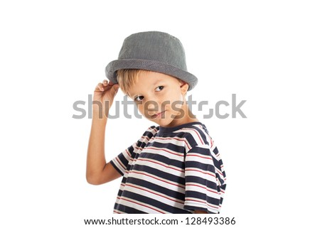 Portrait of a cute brown-eyed boy in the European striped T-shirt and hat. Studio shot, isolated on white background.