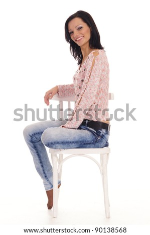 portrait of a cute brunette with chair