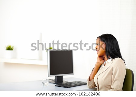 Portrait of a cute business lady looking to the monitor screen with copy space. - stock photo