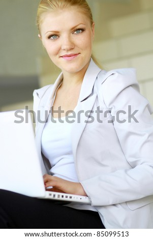 Portrait of a cute business woman with her laptop