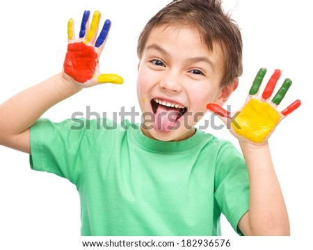 Portrait of a cute cheerful boy showing his hands painted in bright colors, isolated over white - stock photo