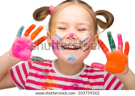 Portrait of a cute cheerful girl with painted hands closed her eyes in joy, isolated over white - stock photo