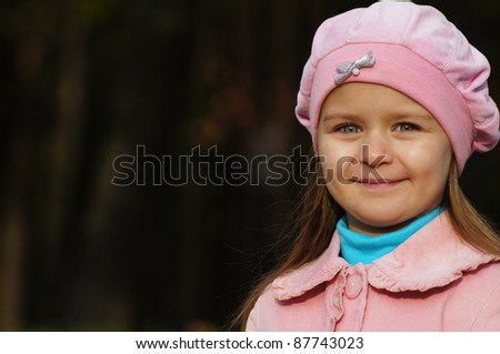 portrait of a cute child at park - stock photo
