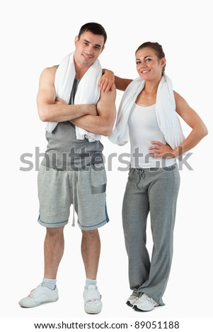 Portrait of a cute couple going to practice sport against a white background - stock photo