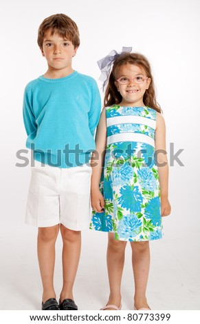 Portrait of a cute couple of brother and sister - stock photo