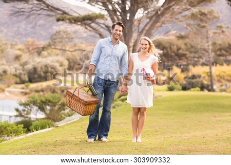 Portrait of a cute couple on date walking in the park