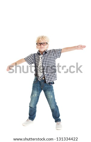 Portrait of a cute curly blond European boy wearing a plaid shirt, tie, jeans, and black-framed glasses. Studio shot, isolated on white background. - stock photo