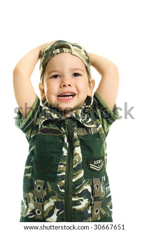portrait of a cute excited three year old boy dressed in camouflage