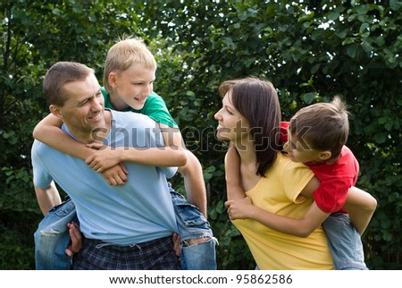 portrait of a cute family at nature - stock photo