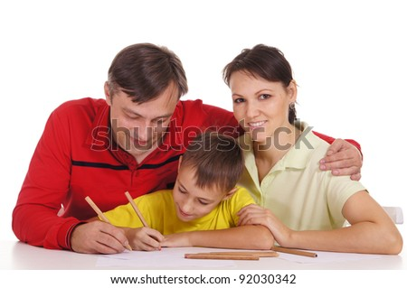 portrait of a cute family drawing at table