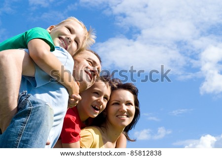 portrait of a cute family on a sky background - stock photo