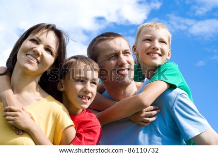 portrait of a cute family on a sky background