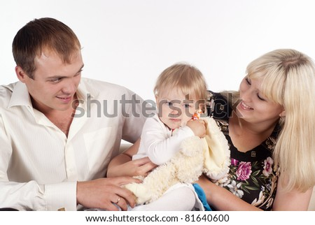 portrait of a cute family playing at sofa