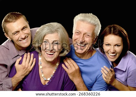Portrait of a  cute family portrait with senior parents - stock photo