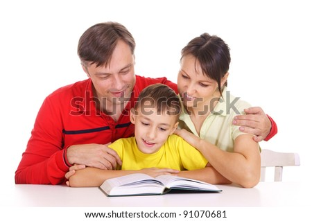 portrait of a cute family reading at table