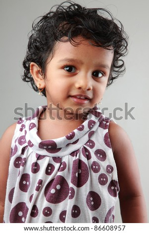 Portrait of a cute girl child - stock photo