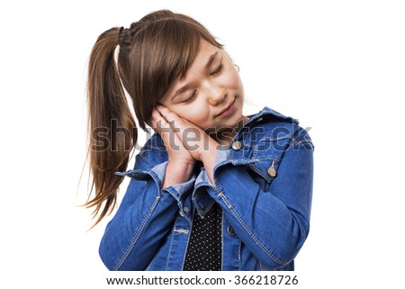 Portrait of a cute girl falling asleep over white background - stock photo
