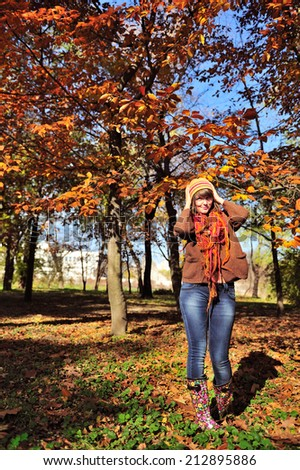 Portrait of a cute girl hiking in park, autumn autdoor. - stock photo