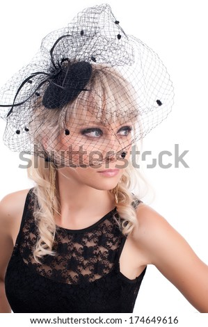 portrait of a cute girl in a black hat with a veil - stock photo