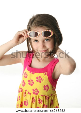 Portrait of a cute girl pulling up sunglasses on head, isolated on white in studio. - stock photo