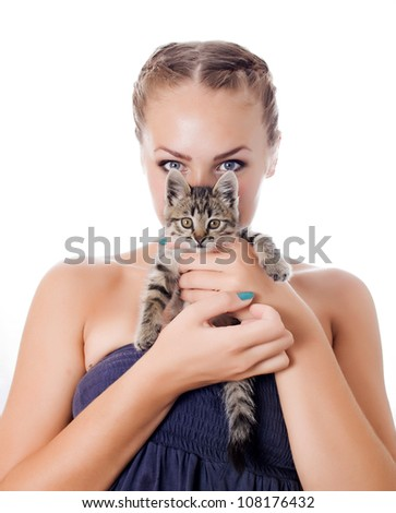 Portrait of a cute girl with a kitten against white background - stock photo