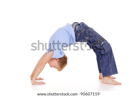 portrait of a cute kids doing gymnastics - stock photo