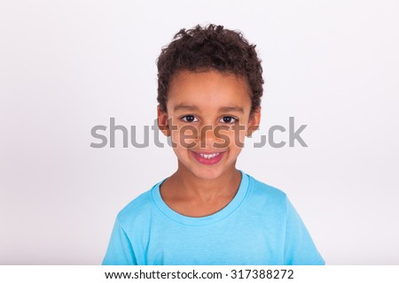 Portrait of a cute little African American boy smiling - stock photo