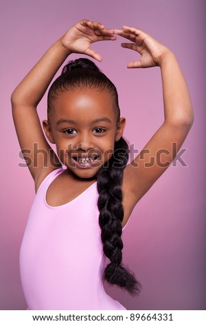 Portrait of a cute little African American girl dancing - stock photo