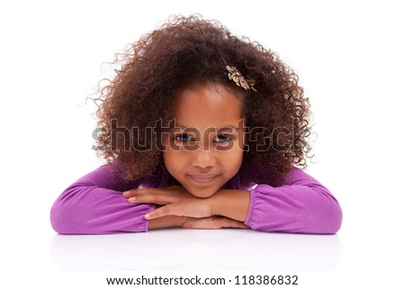 Portrait of a cute little African Asian girl lying down on the floor