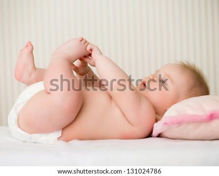 portrait of a cute little baby lying - stock photo
