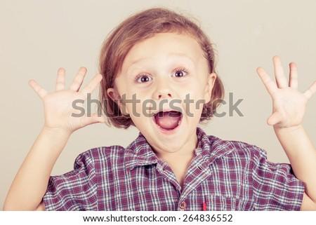 Portrait of a cute little boy - stock photo