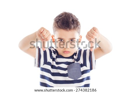 Portrait of a cute little boy giving thumbs down sign with sad expression - stock photo
