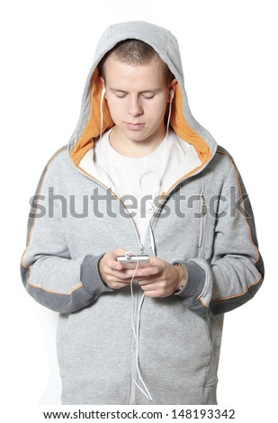 Portrait of a cute little boy listening to music on the mp3 player - stock photo
