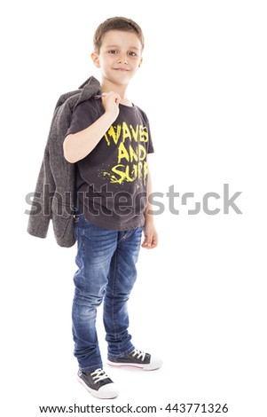 Portrait of a cute little boy posing over white background - stock photo
