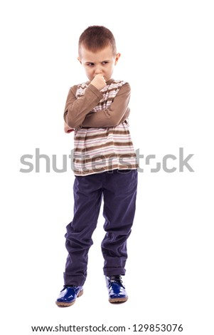 Portrait of a cute little boy thinking hard against white background - stock photo