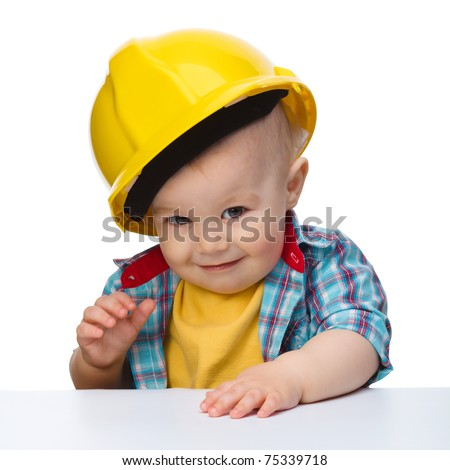 Portrait of a cute little boy wearing oversized hard hat, isolated over white - stock photo