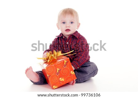 portrait of a cute little boy with gift - stock photo