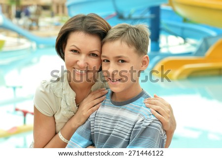 Portrait of a cute little boy with his mother - stock photo