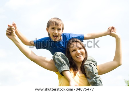 portrait of a cute little boy with mom