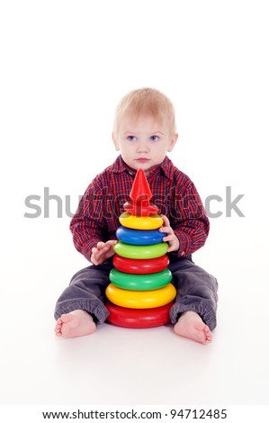 portrait of a cute little boy with toy - stock photo