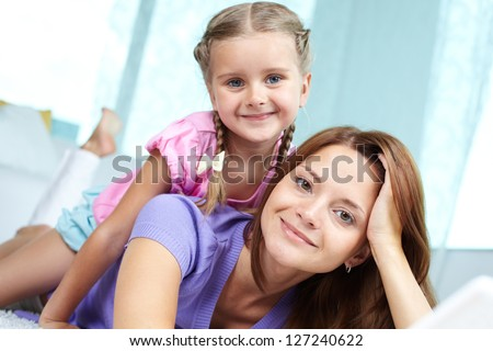 Portrait of a cute little girl and her mom