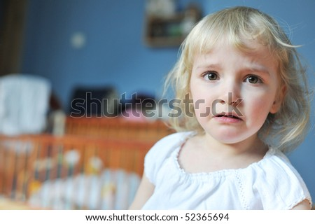 portrait of a cute little girl crying - stock photo