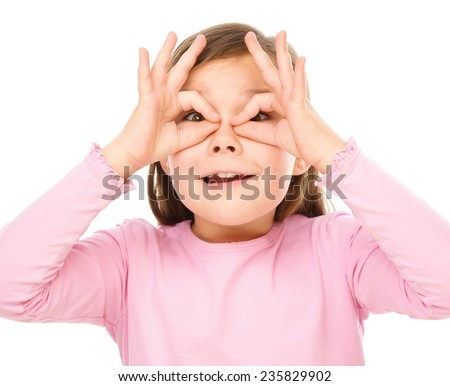 Portrait of a cute little girl showing aviator sign, isolated over white - stock photo