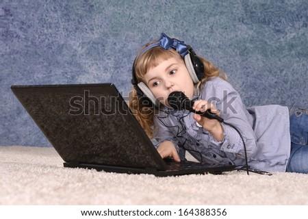 Portrait of a cute little girl with blond curly hair - stock photo