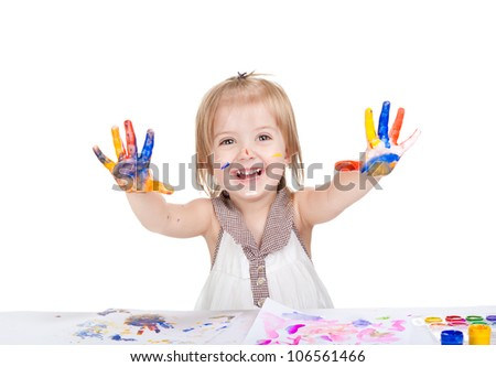 Portrait of a cute little smiling girl with the palms painted by a paint. 2 year happy excited smile child point palm at camera, Isolated on white background - stock photo