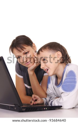 portrait of a cute mom and kid with computer