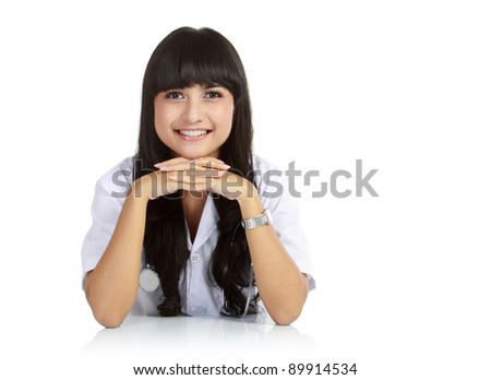 portrait of a cute nurse at table isolated over white background - stock photo