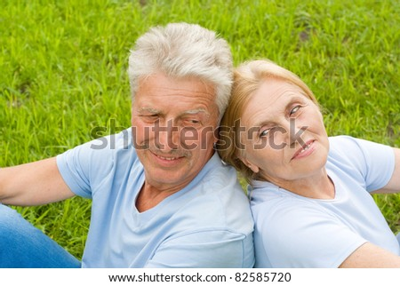 portrait of a cute old couple at nature